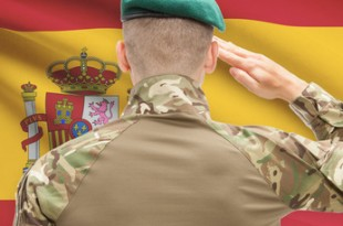 Soldier in hat facing national flag series - Spain